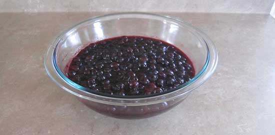 Blueberry-lime jam in pyrex bowl